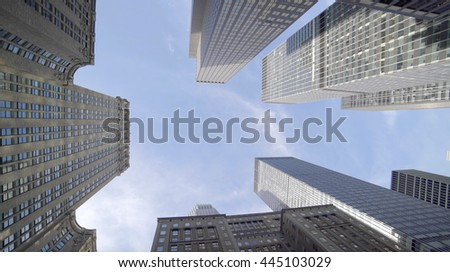 vertical view of high rise skyscraper building in financial business city district. modern architecture background - stock photo