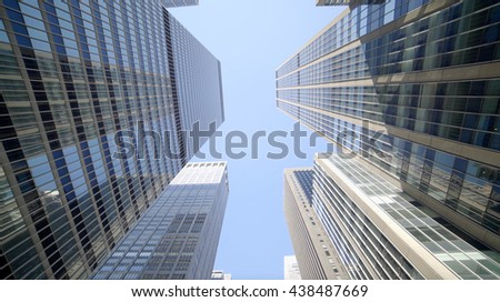 vertical view of modern skyscraper buildings in city business district - stock photo