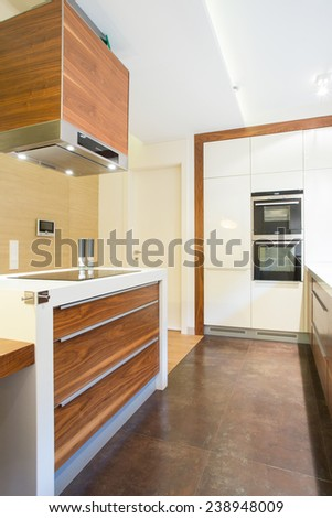 Vertical view of new luxury kitchen with wooden units - stock photo