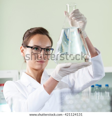 Vertical view of scientist experimenting in laboratory