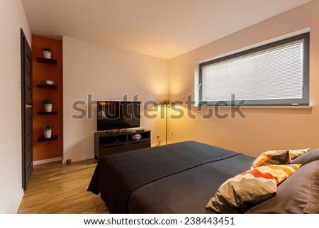 Vertical view of small and cozy bedroom interior - stock photo