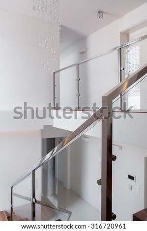 Vertical view of stairs with steel railing - stock photo
