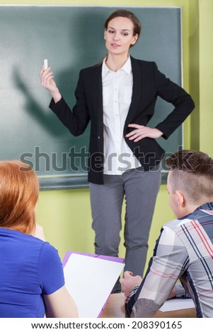 Vertical view of teacher working at school