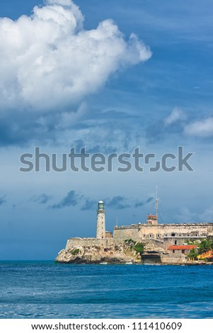 Vertical view of the castle of El Morro, a symbol of Havana, on a beautiful stormy day - stock photo
