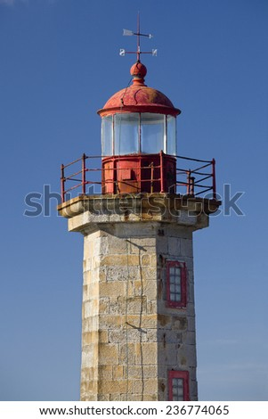 Vertical view of the Douro River Harbor Lighthouse in Porto, Portugal. Porto Lighthouse.