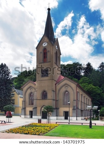 Vertical view of The Evangelical Church on the main square in Dolny Kubin town during sunny day in summer.
