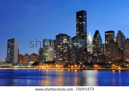 Vertical view of the New York City skyline at midtown Manhattan from across the East River.