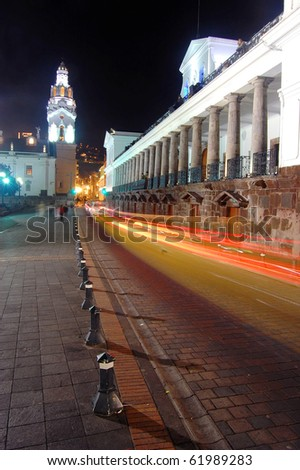 Vertical view of the Presidential home and Cathedral steeple in downtown Quito, Ecuador at night - stock photo