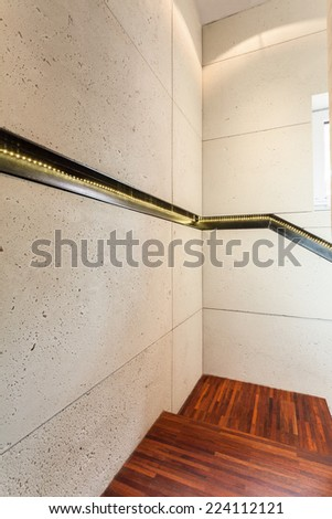 Vertical view of wooden stairs in modern house - stock photo