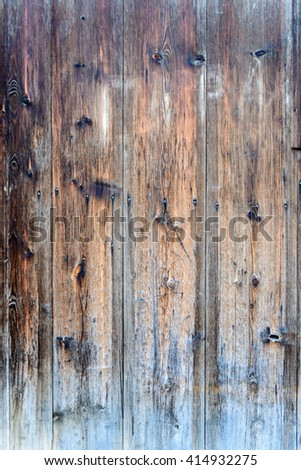 Vertical wood plank fence close up. Detailed background photo texture.