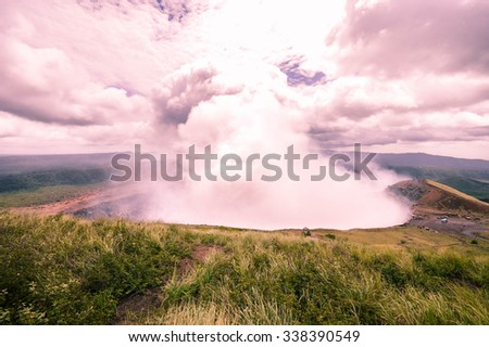 Very active heavily fuming crater of the Masaya-Nindiri volcanic duo in Nicaragua - stock photo