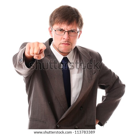 Very angry businessman pointing at the camera over white background - stock photo