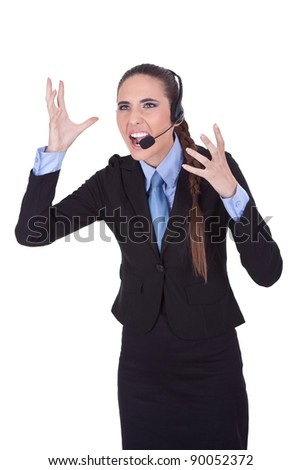 very angry  businesswoman with headset yelling on microphone, isolated a white background - stock photo