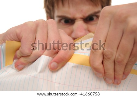 Very Angry student trying to rip papers - stock photo