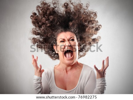 Very angry woman - stock photo