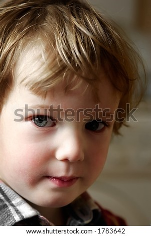 Very attentive sight of the taken offence boy - stock photo