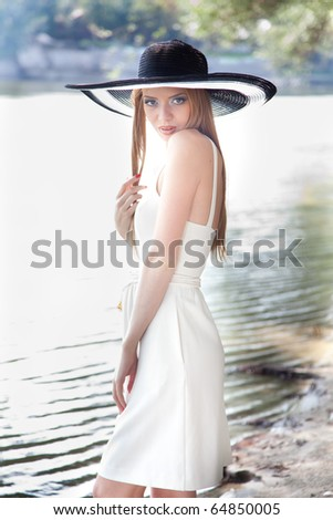 Very attractive girl with elegant hat
