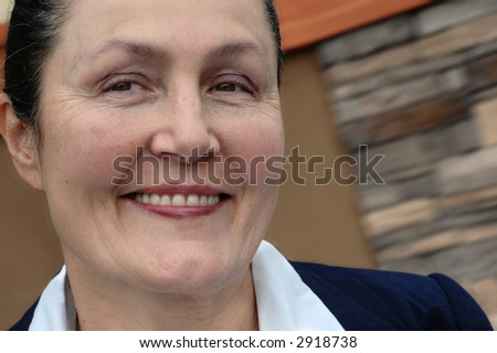 Very attractive older businesswoman smiling a big toothy grin - stock photo