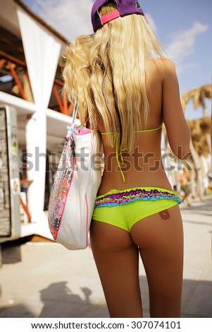 Very attractive women. shot near pool and beach. white tint skin. breast. palms. swimming dress. Lingerie. Nice ass. long legs. athletic body. great hair. tropic - stock photo