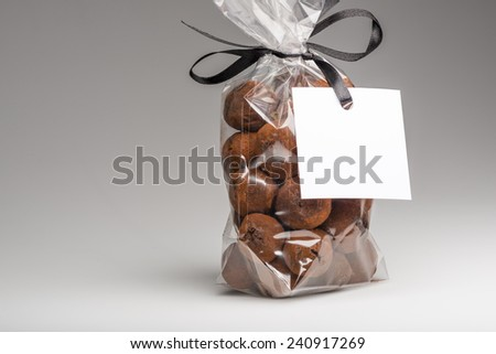 Very beautiful and delicious gift of chocolate truffles and copy space. Blank label that you can add your own trademark or your own message. Fun composition and lighting. Shooting in studio. - stock photo