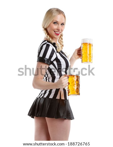 very beautiful and happy woman in soccer style with a big glass of beer in her hands - stock photo