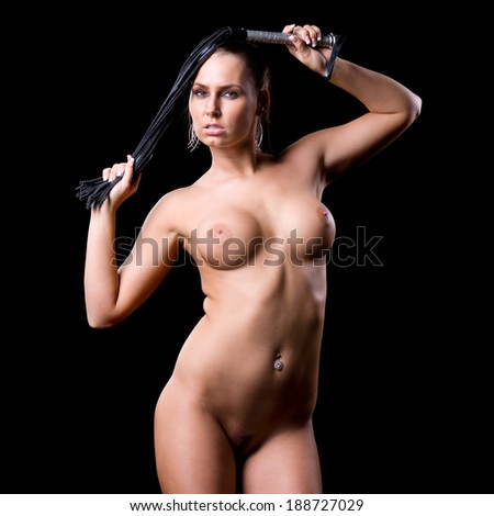 very beautiful and sexy nude or naked woman with a whip in her hands on a dark black background - stock photo