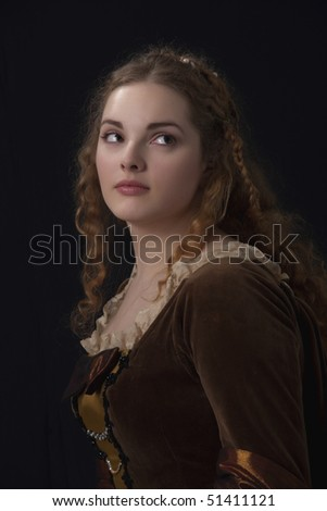 Very beautiful girl in medieval dress in studio look like a old time paynting - stock photo