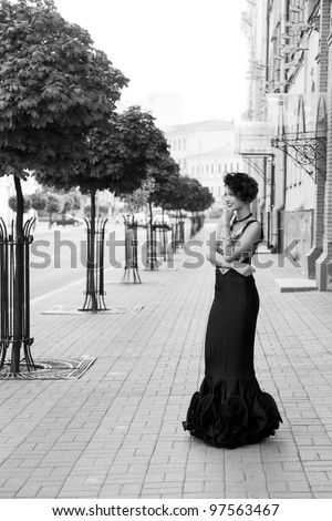 Very beautiful girl in retro style is on the street - stock photo