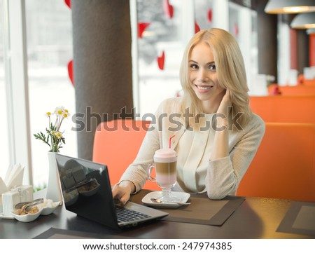 Very beautiful, happy,  young woman, sit in  Cafe  with notebook, horizontal portrait