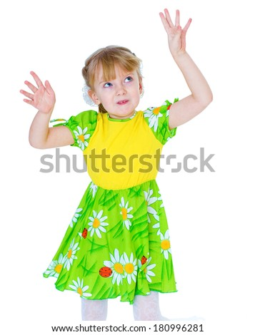 very beautiful little girl in a green summer dress fun posing studio. isolated on white background