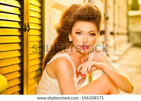 very beautiful model wearing gold make-up - stock photo