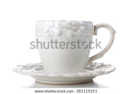 very beautiful porcelain Cup with saucer on white background isolated - stock photo