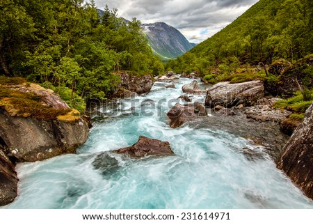 Very beautiful powerful waterfall in Norway with the effect of flowing water - stock photo