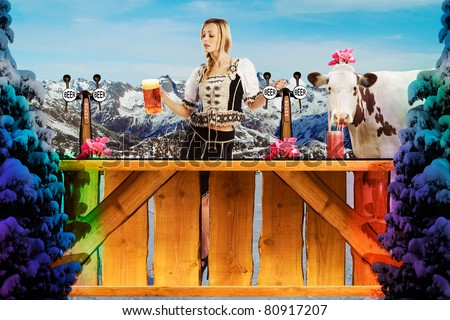 very beautiful tiroler ski girl in the snow behind a bar - stock photo