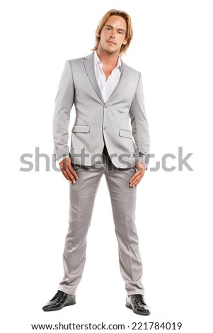 very beautiful well dressed man in suit on a white background - stock photo