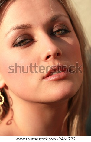 very  beautiful woman face with perfect skin and green eyes - stock photo