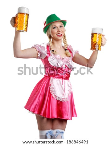 very beautiful woman in tiroler oktoberfest dress or dirndl is holding a big glass of beer in her hands - stock photo
