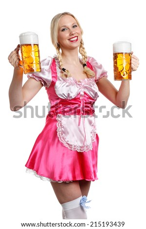 Very beautiful woman in tiroler or oktoberfest outfitl is holding a big glass of beer in her hands and ready to party - stock photo