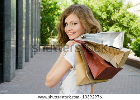 Very beautiful woman with shopping bags