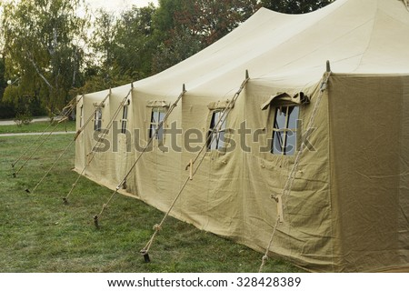 Very big military tent in the forest - stock photo