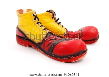 Very big red-yellow clown shoes on white - stock photo