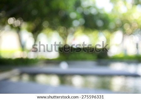 very blur image of outdoor garden for background use - stock photo