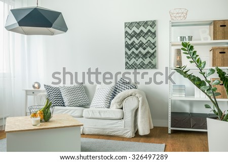 Very bright living room with white furniture - stock photo