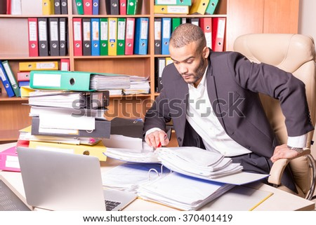very busy man in office