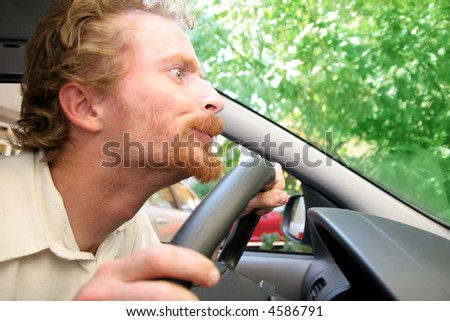 Very carefull driver behind the stearing wheel - stock photo