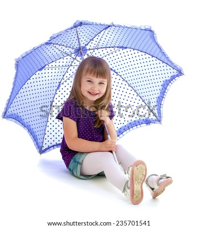 Very cheerful little girl sits under a blue umbrella. Happy childhood, fashion, autumnal mood concept. Isolated on white background - stock photo