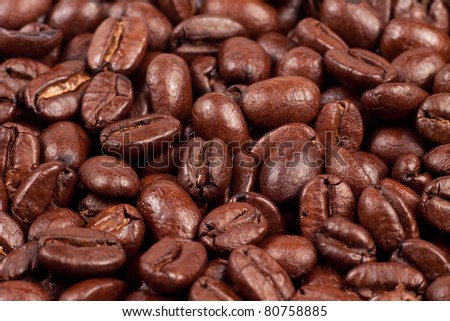 Very close up macro photo of roasted coffee beans - stock photo
