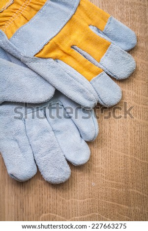 very close up view on protective gloves on wooden boards