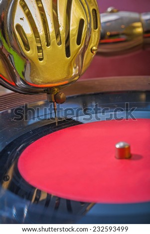 very close up view on speaker and vinil disk of gramophone - stock photo