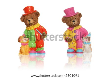 Very colorful teddy bear toys isolated over white with reflection - stock photo